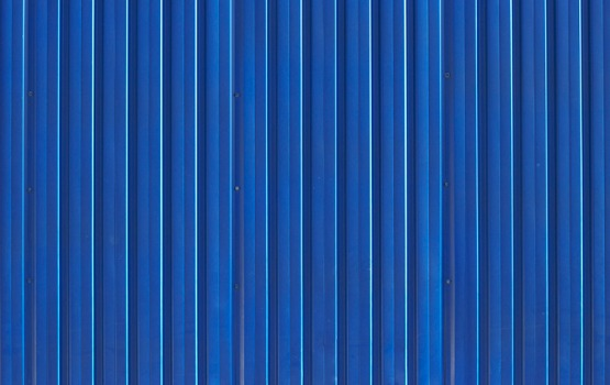 Close-Up on Siding of Blue Patiotainer