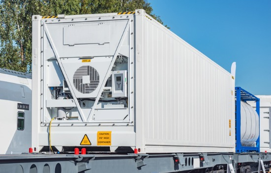 View of Refrigerated Shipping Containers in Illinois on Back of Semi Truck