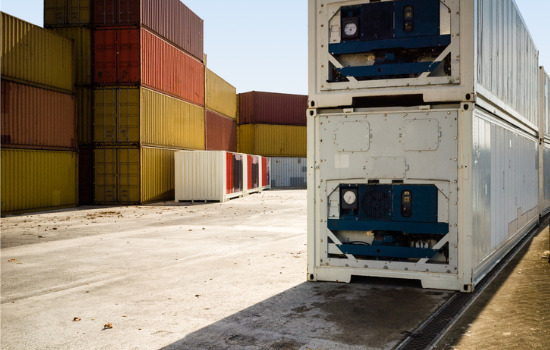 Refrigerated containers for Rockford IL sitting in front of several colorful dry storage containers.